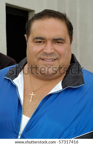 LODI, NJ - OCT. 1: Joe Gannascoli, known as Vito Spatafore in The Sopranos, poses for a photograph outside the Bada Bing on October 1, 2003 in Lodi, NJ.