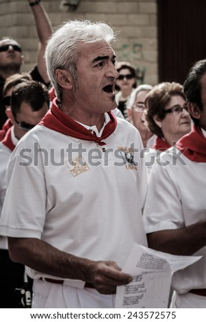 LODOSA, SPAIN - SEPTEMBER 15: A singer of traditional music of Navarra during the festival of Lodosa, Navarra, Spain on September 15, 2013. - stock photo
