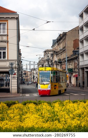 LODZ CITY, POLAND - MAY 17,  2015: A tram at the Legionow Street at Liberty Square. Popular public transport vehicle  in the City - stock photo