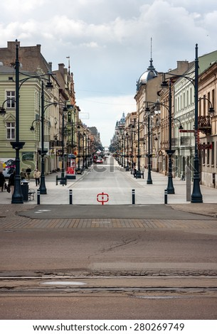 LODZ CITY, POLAND - MAY 17,  2015: View of Piotrkowska Street from the Liberty Square. Main shopping street and part of the tramway - stock photo