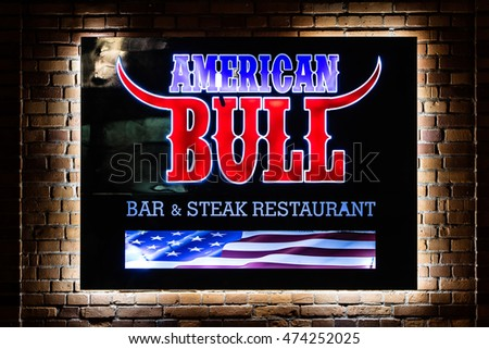 Lodz, Poland, August 26, 2016, night, American Bull Bar & Steak restaurant sign, neon