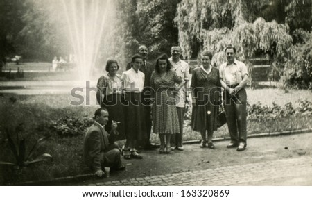 LODZ,POLAND, CIRCA FIFTIES -  unidentified big family members posing outside, in the garden - circa fifties
