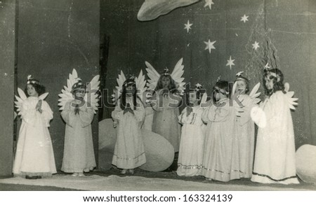 LODZ,POLAND, CIRCA FIFTIES - vintage photo of unidentified little girls in angels' costumes during Christmas play performance - in Lodz, Poland, circa fifties - stock photo