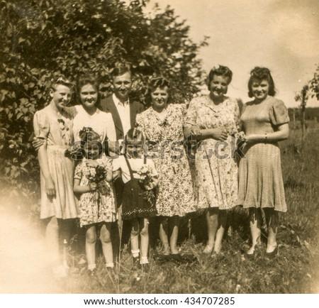 LODZ, POLAND, CIRCA 1940's: Vintage photo of family outdoor - stock photo