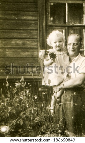 LODZ, POLAND, CIRCA 1950's: Vintage photo of father with little daughter