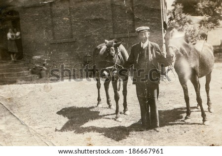 LODZ, POLAND, CIRCA 1950's: Vintage photo of man with two horses