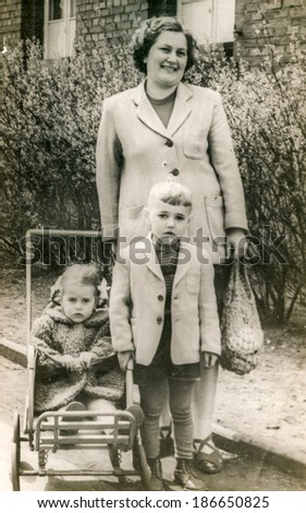 LODZ, POLAND, CIRCA 1950's: Vintage photo of mother with children