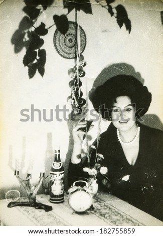 LODZ, POLAND - CIRCA 1970's: Vintage photo of woman drinking some wine