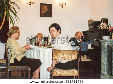 LODZ, POLAND, CIRCA 1990: Vintage photo of four generation family during a Christmas party - stock photo