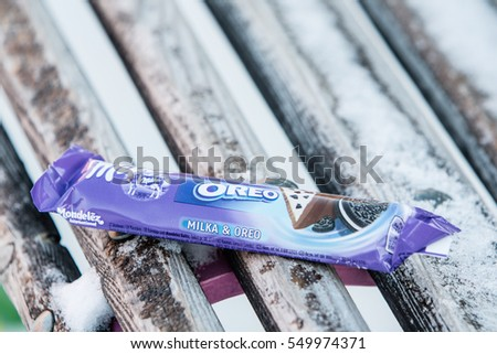 Lodz, Poland, January 06, 2017: Milka and Oreo two chocolates in one bar