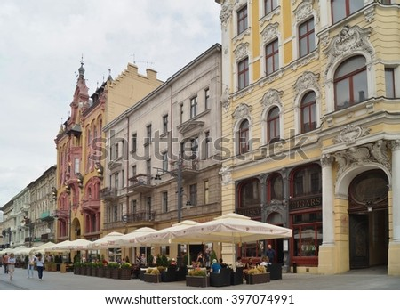 LODZ, POLAND ,12 JULY , 2015: Piotrkowska Street in Lodz . Main shopping street. Sunday afternoon on Piotrkowska Street.
