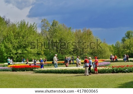 LODZ, POLAND,08 MAY 2016: Beautiful tulips - 50,000 tulips in the Botanical Garden in Lodz - walk among the tulips