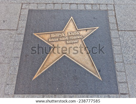 LODZ, POLAND - OCTOBER 19, 2014: Brass star for Henryk Kluba on Walk of Fame on central Piotrkowska Street in Lodz, Poland. Henryk Kluba (1931-2005) was a Polish actor and film director - stock photo