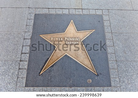 LODZ, POLAND - OCTOBER 19, 2014: Brass star for Roman Polanski  on Walk of Fame on Piotrkowska Street in Lodz, Poland. Roman Polanski is a naturalized-French film director, producer, writer, and actor - stock photo