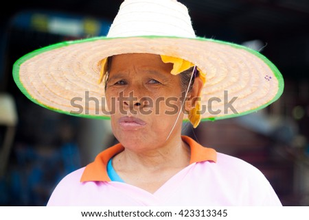 LOEI, THAILAND, MAY 14, 2016 : The lady - Thai rice farmer worry about there rice field. No water from Irrigation water to grow rice after few month have no rain.  - stock photo