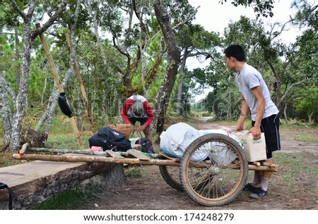 LOEI, THAILAND - OCT 13: Unidentified porters carry climbers' belongings on 13 October 2013 at Phu Kradueng National Park, Loei, Thailand