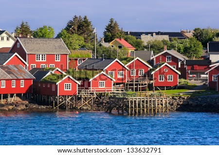 Lofoten is an archipelago and a traditional district in the county of Nordland, Norway. Nordic Fishing Houses by the Sea - stock photo