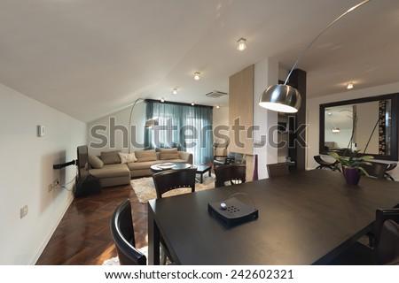 Loft apartment interior, dining area - stock photo