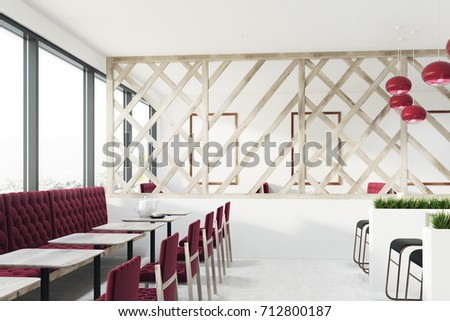 Loft Cafe Interior With A Wooden Decorative Wall, Red Armchairs And Sofas  And Small Square
