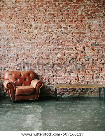 Brown red brick wall with leather sofa and minimalist wooden