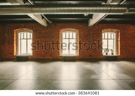 Loft studio Interior in old house. Big windows, brick red wall - stock photo