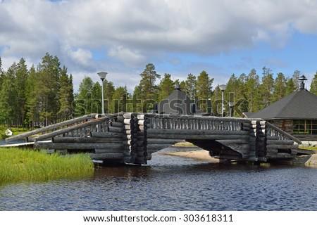 Log bridge over river north. Finland, Lapland - stock photo