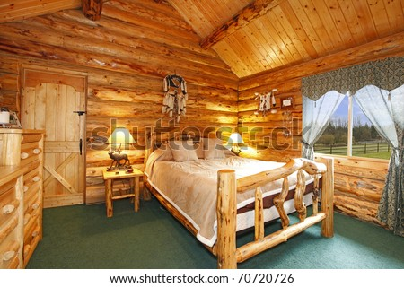 Log cabin bedroom with rustic wood design - stock photo