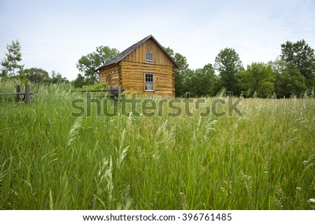 Log cabin from 1800s with rail fence at the Traverse des Sioux historical site - stock photo