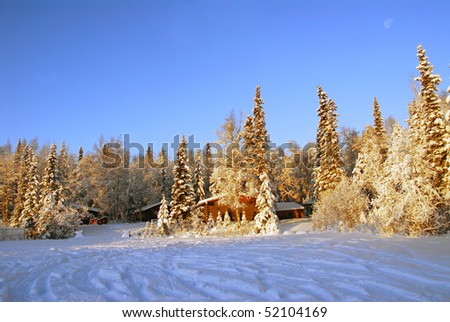 Log cabin in Alaska in winter
