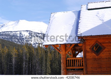 Log cabin in Canadian Rocky mountains at Lake Louse - stock photo