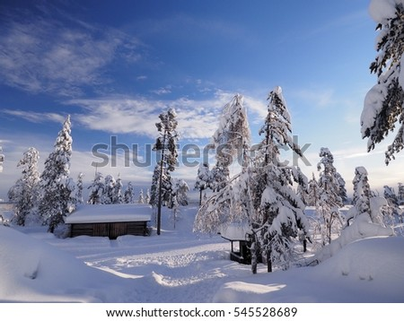 log cabin in snow forest