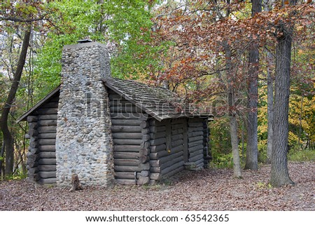 Log Cabin in the beginning of autumn - stock photo