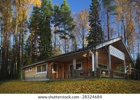 Log cabin in the forest - stock photo