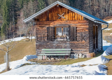 Log cabin in the mountains - winter time