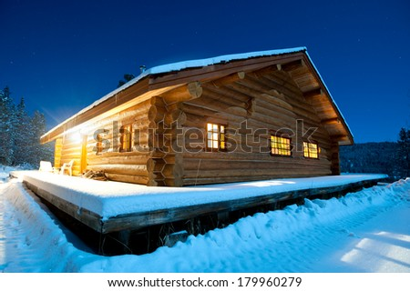 Log cabin in the snow, Canada - stock photo