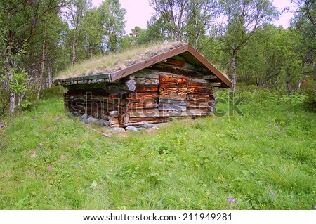 log cabin in the woods - stock photo