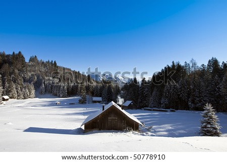 log cabin in winter - stock photo