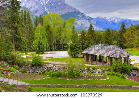 Log cabin surrounded by the forest at Banff National Park in Alberta, Canada - stock photo