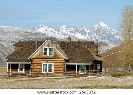 Log House with Grand Tetons in the background - stock photo