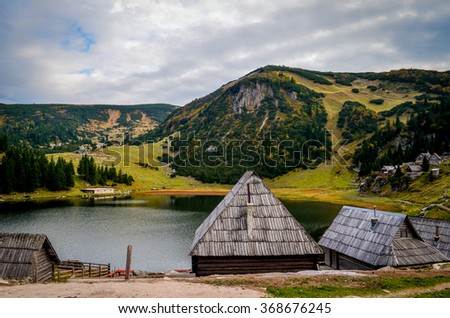 Log houses nearby the Prokosko lake  - stock photo