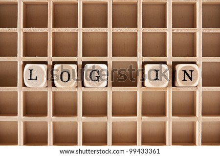 Log-in word construction with letter blocks / cubes and a shallow depth of field - stock photo
