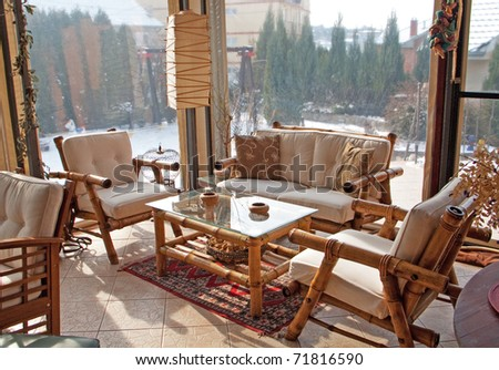 Loggia with stylish wooden furniture - stock photo
