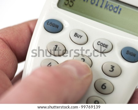 logging in to an internet bank through an electronic safety device - stock photo