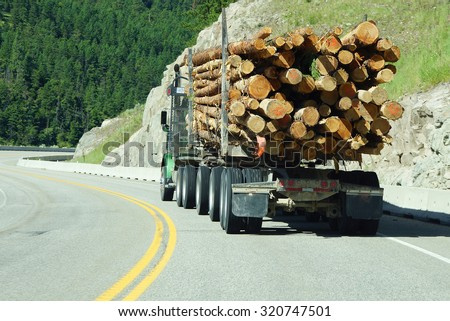 Logging truck on mountain highway,   British Columbia, Canada - stock photo