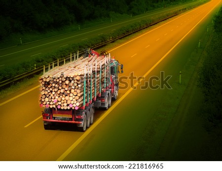 Logging truck on the highway. - stock photo