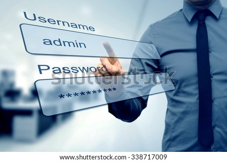 login box - finger pushing username and password fields - stock photo