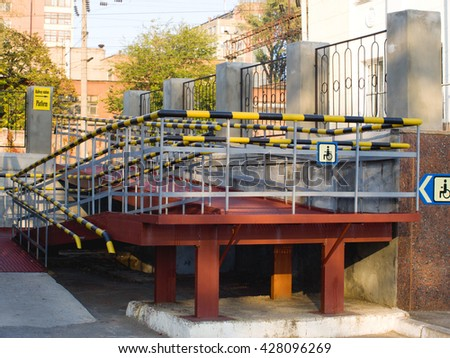 Login with wheelchair accessible at the railway station - stock photo