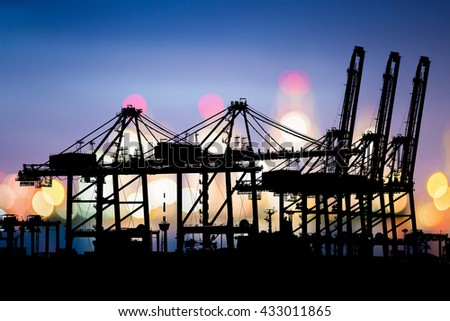 Logistic Import Export background, Bokeh of Port cranes working at night in sea port, Shipping, Logistics. - stock photo