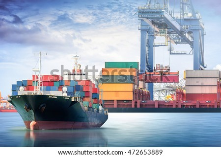 Logistics and transportation of Container Cargo ship with working crane bridge in seaport.
