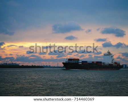 Logistics and transportation of International Container Cargo ship in the river at twilight sky, Freight. with copy space.